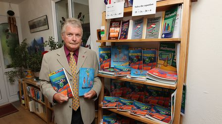 Gareth Rowlands with a selection of his Maths text books which are used around the world