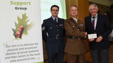 Gordon Dyer, from the Acorn Cancer Support Group, receives from Capt Andrew Sargeant and Sgt Kenneth