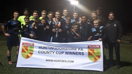 St Neots Town celebrate their Hunts Under 18 Cup triumph. Picture: HUNTS FA