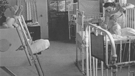 A child in an iron lung