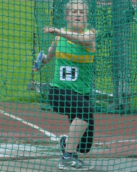 Willow Bedding of Hunts AC during her discus success.