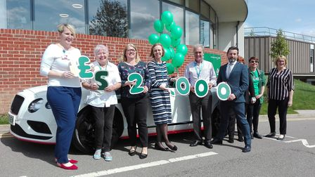 Balloons were released from a Bentley to marrk £52,000 being raised for Macmillan by car firm Vindis
