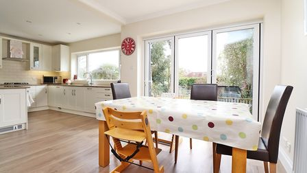 The modern fitted kitchen/diner has bi-folding doors
