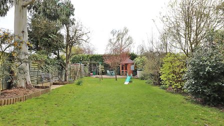 The large rear garden has two paved patio areas ideal for entertaining and an attractive summer hous