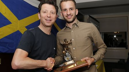 Sam Merson is presented with the supporters player of the year by Lawrence Levy. Picture: LEIGH PAGE