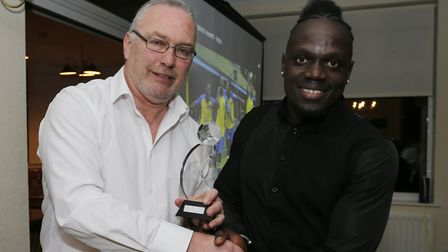 Solomon Sambou picking up the award for young player of the year from manager Ian Allinson. Picture: