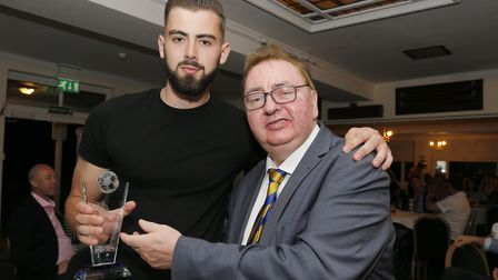 Club president Malcolm MacMillan presents Dean Snedker with the players' player of the season award.
