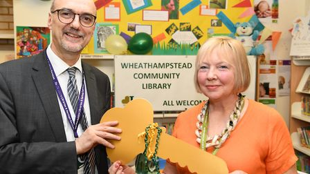Head of libraries and heritage services Andrew Bignel hands over the key for Wheathampstead Communit