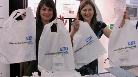 Nikki Sharkey and Ruth Bradford handing out bags with information about becoming a member of Hertfor