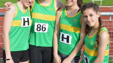 The successful Hunts AC Under 15 Girls 4-100m relay squad of Ella Reed, Lizzy Harrison, Lucy England
