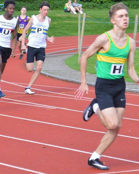 Julian Priest on his way to 200m victory for Hunts AC.