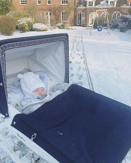 Baby Rosie having a snooze in the family's huge back garden (@samanthafaiers/Instagram)