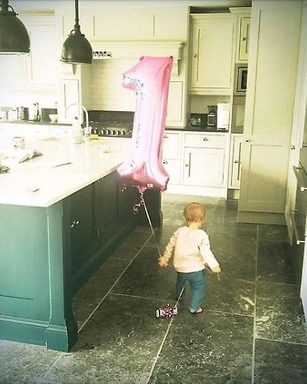 Emma marked daughter Trixie's first birthday with this photo, taken in the family's huge kitchen (@e
