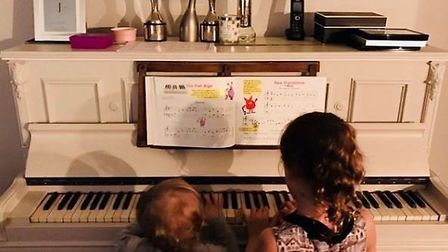 Emma's daughters tinkling the ivories - with just a few Brit Awards on display... (@emmawillisoffici