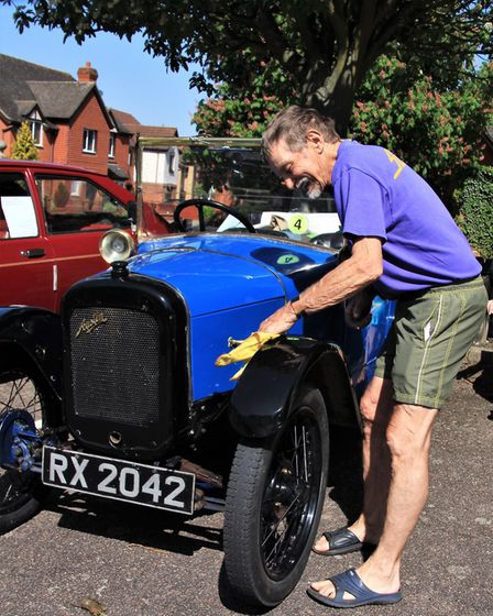 Si Holder making final adjustments to his 1926 Austin Chummy. Picture: Clive Porter