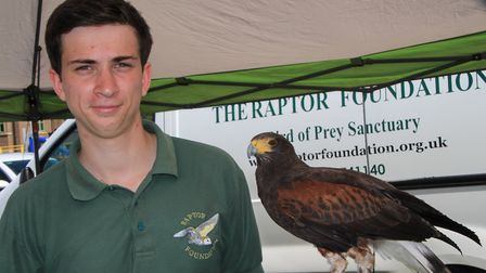 Elliott Hall of The Raptor Foundation with a harris hawk called Gem. Picture: Clive Porter
