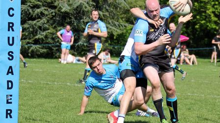 St Albans Centuriona' Nick Woolley is dragged down just before the tryline. Picture: DARRYL BROWN
