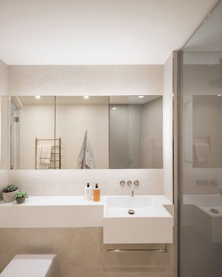 The bathroom is notable for its all-in-one sink, shelf and facia unit. Instead of a flush handle th