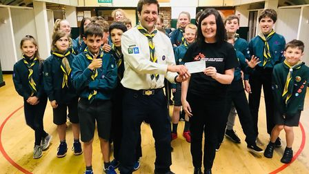 4th St Albans Scouts handing a cheque to MSF.