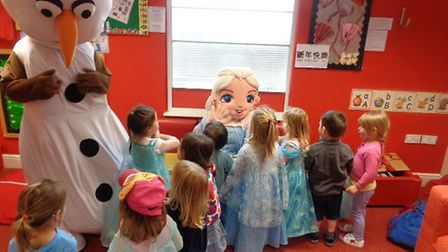 Children at Monkey Puzzle nursery meeting Olaf and Elsa from Frozen.