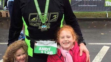 Andy with his two daughters