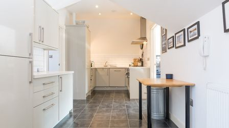 The kitchen area leads to an open plan living room