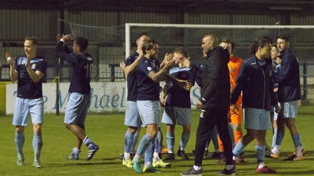 Manager Matt Clements congratulates his St Neots Town players following their Hunts Senior Cup trium