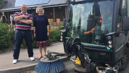 Melbourn councillors Jose Hales and Philippa Hart with the street-sweeper that can be used by commun