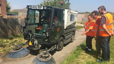 Volunteers Tim, Stuart and Richard have been trained up to use the street sweeper. Picture: SCDC