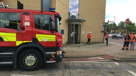 Firefighters extinguish a fire in the roof of Cambridgeshire County Council's Scott House offices in