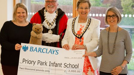A cheque was handed over to Priory Parks Infants School