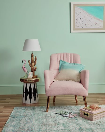 Soft sage is complemented by pinks and metallic touches. Image features Pink Chair, £179.99; Glass F