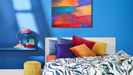 A balanced colour scheme takes inspiration from a painting, featuring Table Lamp, £20; Red Trinket B