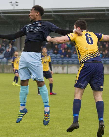 St Neots Town striker Nabil Shariff gets off the ground against Gosport Borough. Picture: CLAIRE HOW