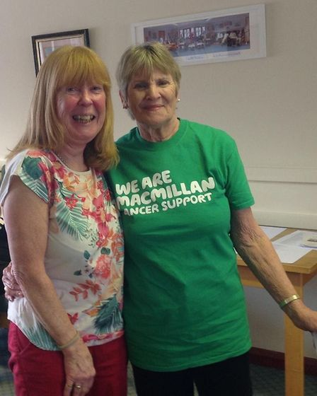Hazell, charity treasurer, presented a cheque to Jean, from Macmillan.