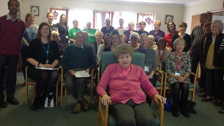 Rose Kilby in pink at front who started the charity shop in 1965, with cheque recipients