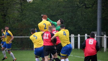 Tring keeper punches clear. Picture: Kevin Lines