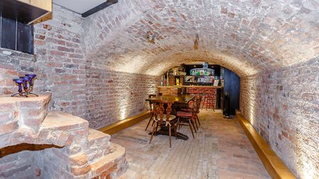 The brick vaulted cellar has a spacious dining room
