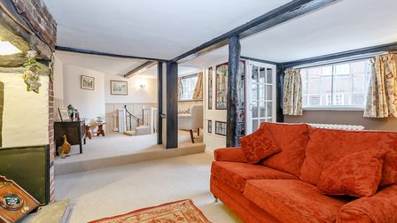 The living room spans the full width of the property