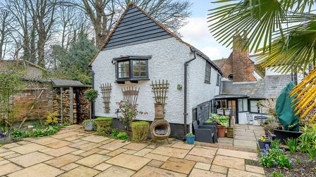 The property boasts a low maintenance walled garden with paved and decked terraces