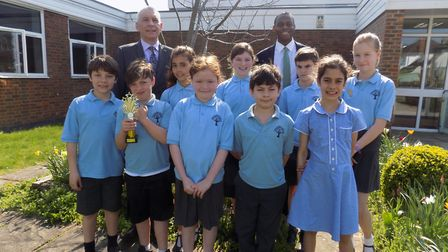 Mr Afolami and Mr Emeny with the pupils who were their class' stars of the week.