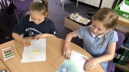 Children at Tannery Drift First School get stuck in making cover art. Picture: Creative Royston