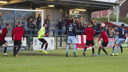 Tom Wood heads St Neots Town's third goal during their Hunts Senior Cup final success. Picture: CLAI