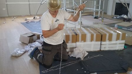 The chandeliers being installed at the new St Albans Museum and Gallery. (Picture: Annie Brewster)