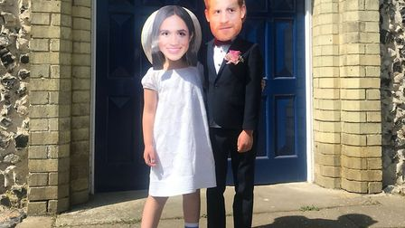 The happy couple: Jocelyn, aged five, and Max, six, outside Therfield Chapel. Picture: Therfield Fir