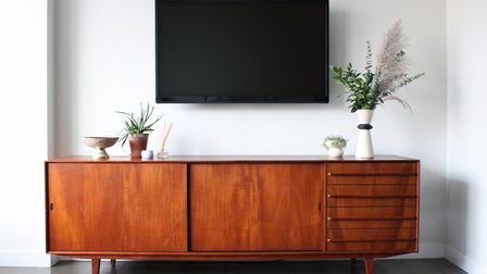 """A 50"""" flat screen TV and a teak sideboard from the '60s might just be the perfect mix of old and new"""