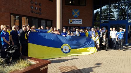St Albans City fans gather outside of the council offices.