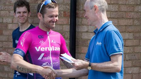Verulam Reallymoving's Marcel Six recieves his winner's prize from Verulam Cycling Club chairman Dou