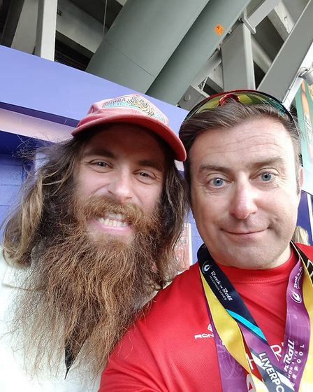 'Forest Gump' style runner Rob Pope with Steve Mowles of Harpenden Arrows.