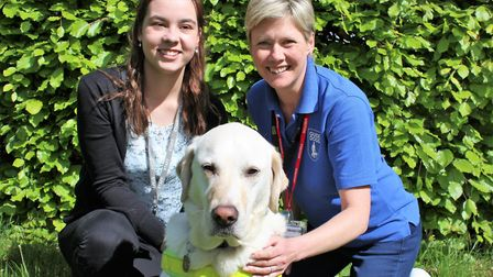 Kate Vallory with her guide dog Becket and a representative from Guide Dogs UK.